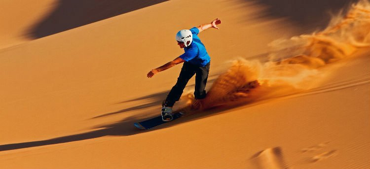 Sandboarding in Dubai - Extreme sports to do in the desert